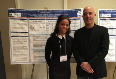 Dr. William Latimer with Michelle Mack and her research poster